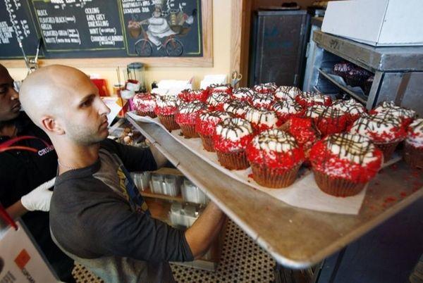 Crumbs Bake Shop managing partner Harley Bauer carries