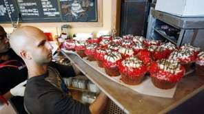 Crumbs Bake Shop managing partner Harley Bauer carries