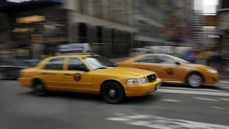 New York City taxis drive through Times Square