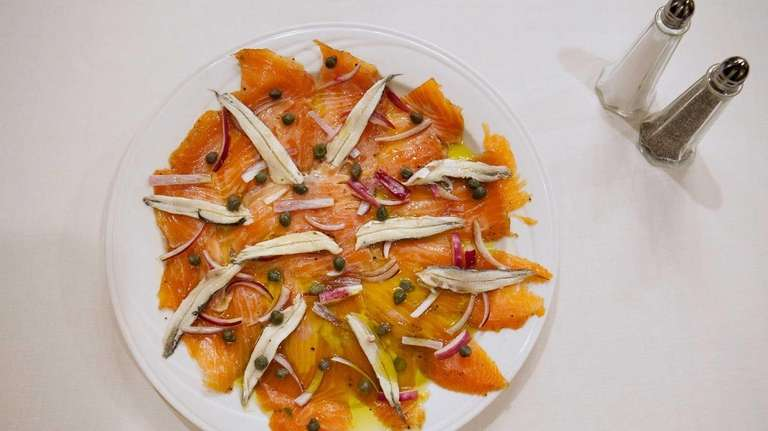 Salmon carpaccio with white anchovies is the perfect