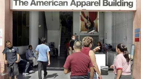 American Apparel employees head to work on Sept.