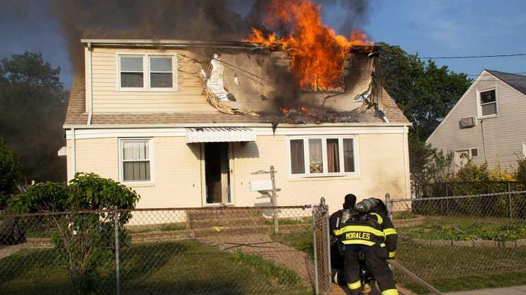 Firefighters battle a house fire on Union Drive
