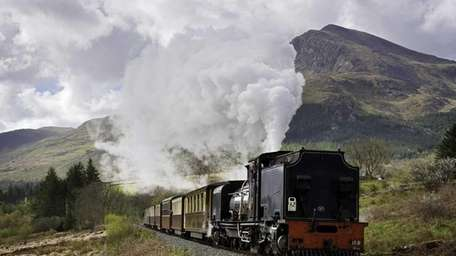 A Welsh Highland locomotive passes through the hamlet