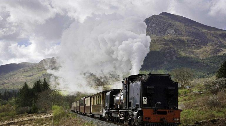 A Welsh Highland locomotive passes through the hamlet