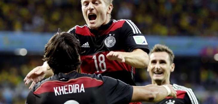 Germany's Toni Kroos celebrates with Sami Khedira and