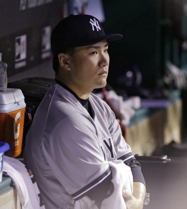Yankees starting pitcher Masahiro Tanaka watches from the