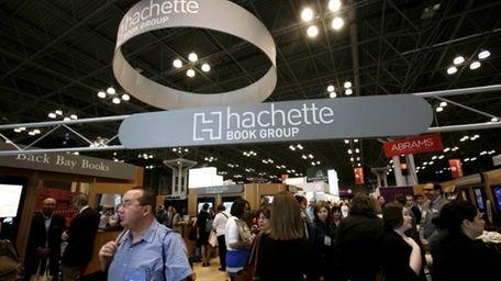 Visitors walk through the Hachette Book Group exhibition