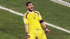 Argentina's goalkeeper Sergio Romero celebrates after saving a