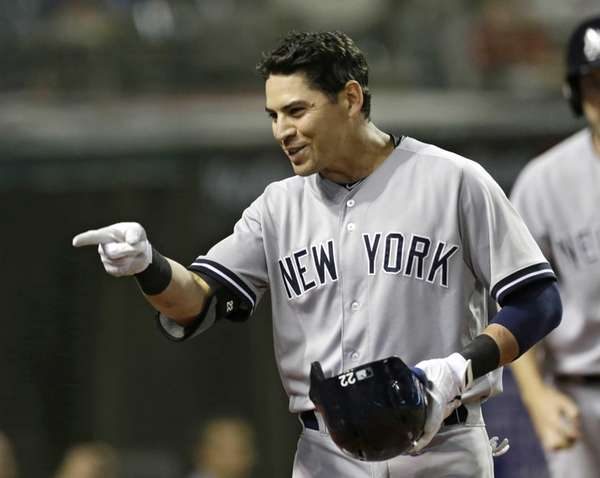 The Yankees' Jacoby Ellsbury points into the dugout