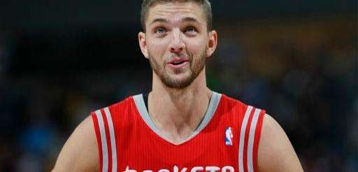 Houston Rockets forward Chandler Parsons looks on against