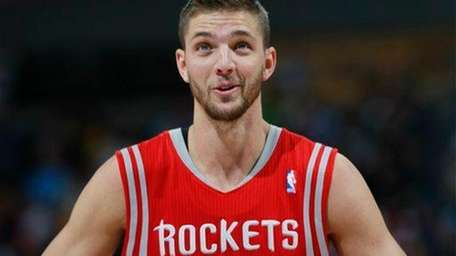 Houston Rockets forward Chandler Parsons looks on against