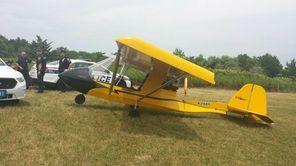 Suffolk County officials tow a plane behind Spadaro