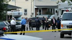 Police and law enforcement officials gather on Stewart