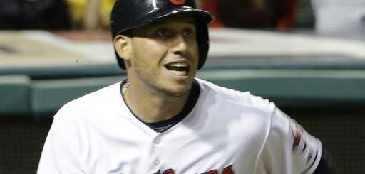 Cleveland Indians' Asdrubal Cabrera watches his ball after