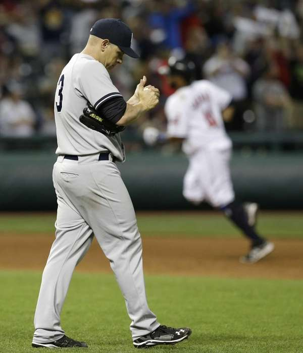 Yankees' Jim Miller, left, waits for Cleveland Indians'