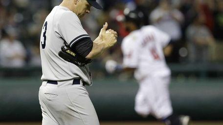 Yankees' Jim Miller, left, waits for Cleveland Indians'
