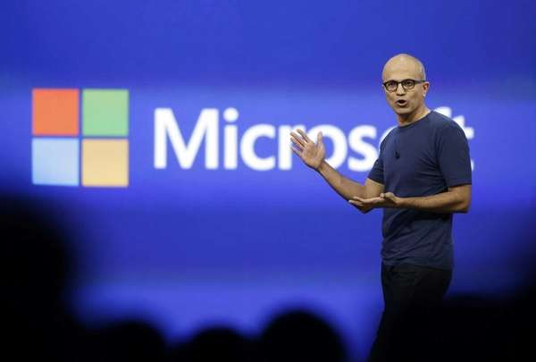 Microsoft CEO Satya Nadella gestures during the keynote