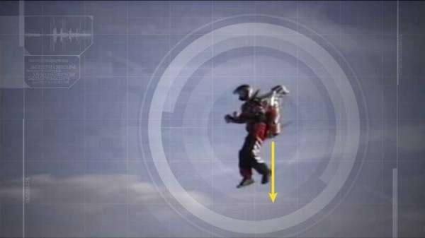 A man hovering with a jet pack, an