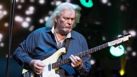Chris Squire of the British band Yes performs
