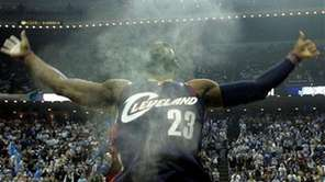 Cleveland Cavaliers forward LeBron James (23) throws up