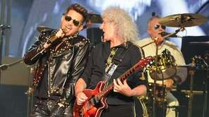 Adam Lambert, left, and Brian May of Queen