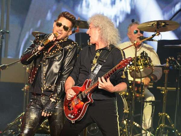 Adam Lambert and Brian May of Queen perform