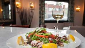 Grilled octopus is served as an appetizer at