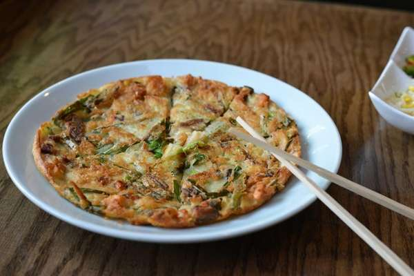 The seafood pajeon, a scallion pancake with clams,