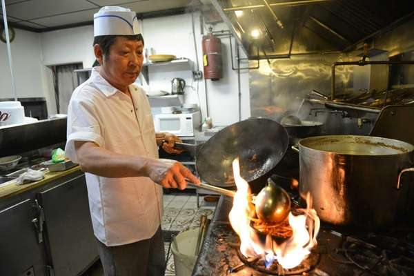 Chef Y.H. Kim works on the hot stone-bowl