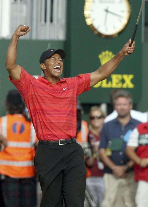 Tiger Woods celebrates after winning the British Open