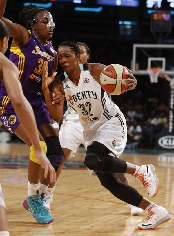 Liberty's Swin Cash drives against Los Angeles Sparks'
