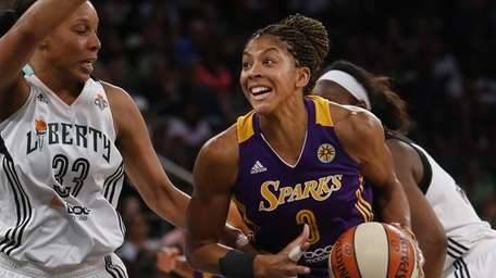 The Los Angeles Sparks' Candace Parker drives against