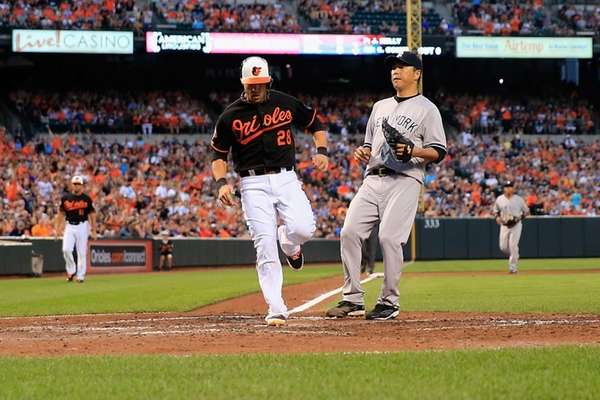 Steve Pearce of the Baltimore Orioles scores a
