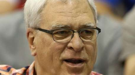 Knicks president Phil Jackson watches his team play