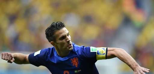 Netherlands' forward and captain Robin van Persie celebrates