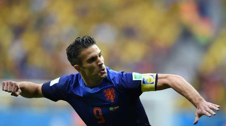 Netherlands' forward and captain Robin van Persie celebrates