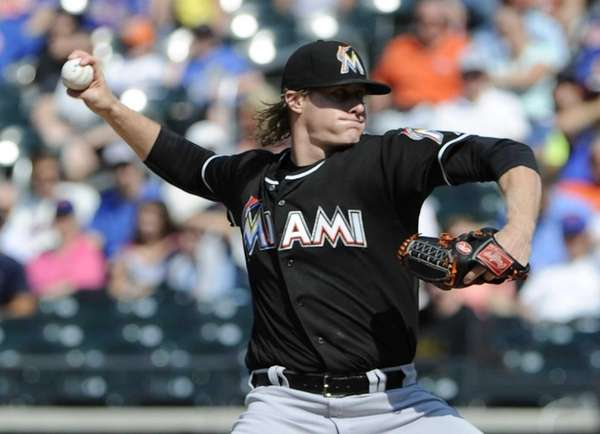 Miami Marlins starting pitcher Tom Koehler delivers against