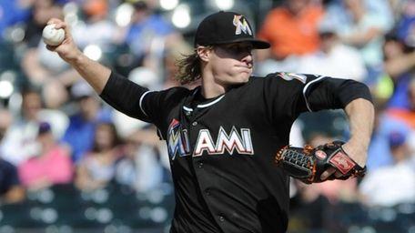 Miami Marlins starting pitcher Tom Koehler delivers against