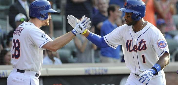 The Mets' Daniel Murphy congratulates Chris Young on
