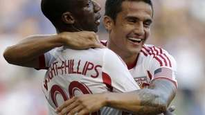 Red Bulls' Bradley Wright-Phillips, left, and Tim Cahill