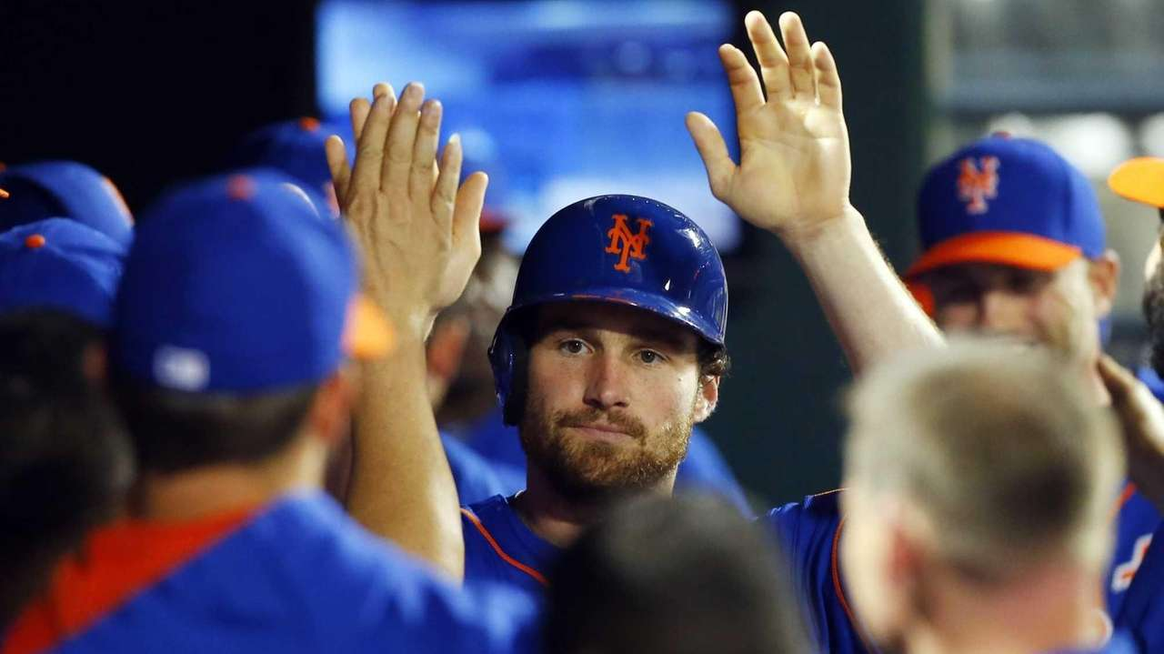Daniel Murphy of the Mets celebrates after scoring