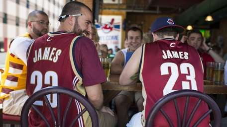 Fans wearing Lebron James shirts gather at a