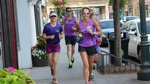 Ultramarathoner Eva Casale, 49, of Glen Cove, right,