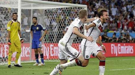 Germany's Mario Goetze, right, celebrates after scoring the