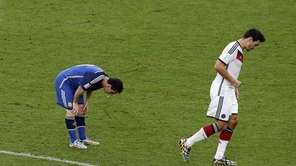 Argentina's Lionel Messi vomits as Germany's Mats Hummels