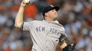 Yankees pitcher Chase Whitley delivers against the Baltimore