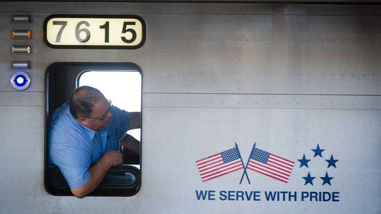 An LIRR conductor checks on a commuter at
