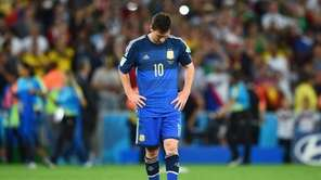 A dejected Lionel Messi of Argentina reacts after