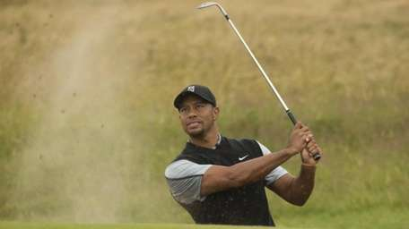 Tiger Woods of the US plays a shot