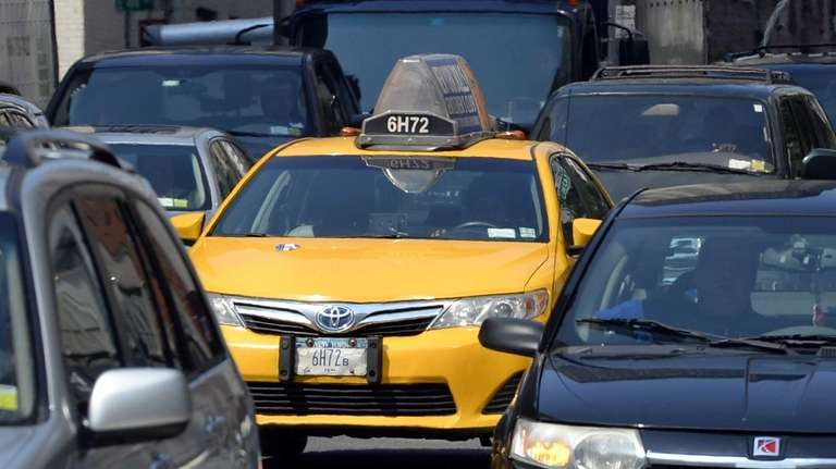 A taxi makes its way down Second Avenue
